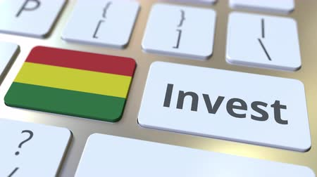 vermögen : INVEST text and flag of Bolivia on the buttons on the computer keyboard. Business related conceptual 3D animation Videos