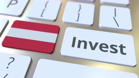 капитал : INVEST text and flag of Austria on the buttons on the computer keyboard. Business related conceptual 3D animation