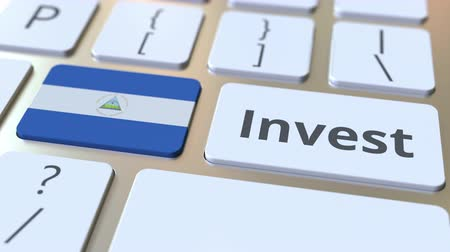 nicaraguan : INVEST text and flag of Nicaragua on the buttons on the computer keyboard. Business related conceptual 3D animation Stock Footage
