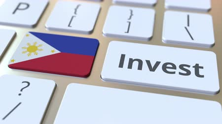 philippine : INVEST text and flag of Philippines on the buttons on the computer keyboard. Business related conceptual 3D animation