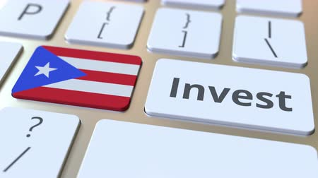 bens : INVEST text and flag of Puerto Rico on the buttons on the computer keyboard. Business related conceptual 3D animation Stock Footage