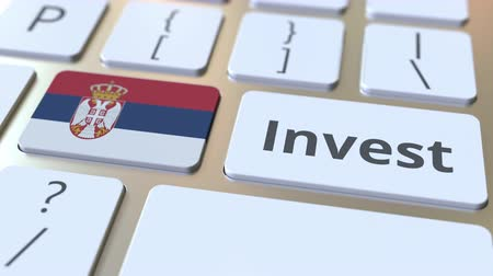 sérvia : INVEST text and flag of Serbia on the buttons on the computer keyboard. Business related conceptual 3D animation