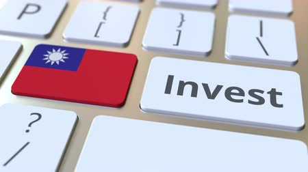 de ativos : INVEST text and flag of Taiwan on the buttons on the computer keyboard. Business related conceptual 3D animation Stock Footage
