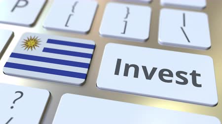 Уругвай : INVEST text and flag of Uruguay on the buttons on the computer keyboard. Business related conceptual 3D animation