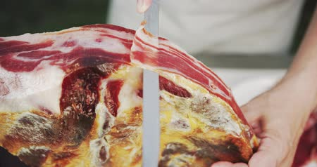 вылеченный : Slicing jamon. Close-up shot on Red