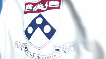 flapping : Flying flag with University of Pennsylvania emblem, close-up. Editorial loopable 3D animation Stock Footage