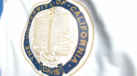 mais alto : Waving flag with University of California Davis emblem, close-up. Editorial loopable 3D animation