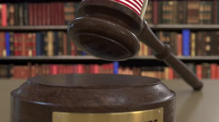 jurisdiction : Flag of the United States on falling judges gavel in court. National justice or jurisdiction related conceptual 3D animation