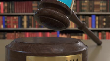 jurisdiction : Flag of Tanzania on falling judges gavel in court. National justice or jurisdiction related conceptual 3D animation
