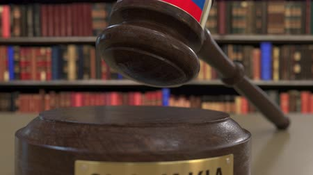 jurisdiction : Flag of Slovakia on falling judges gavel in court. National justice or jurisdiction related conceptual 3D animation