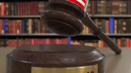 jurisdiction : Flag of Puerto Rico on falling judges gavel in court. National justice or jurisdiction related conceptual 3D animation Stock Footage