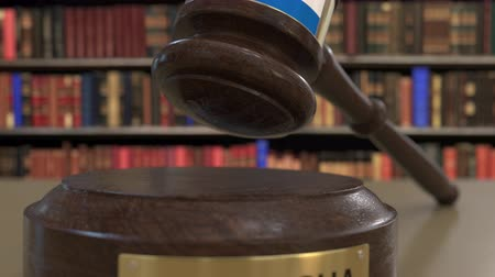 nicaraguan : Flag of Nicaragua on falling judges gavel in court. National justice or jurisdiction related conceptual 3D animation