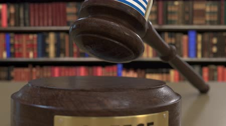 jurisdiction : Flag of Greece on falling judges gavel in court. National justice or jurisdiction related conceptual 3D animation