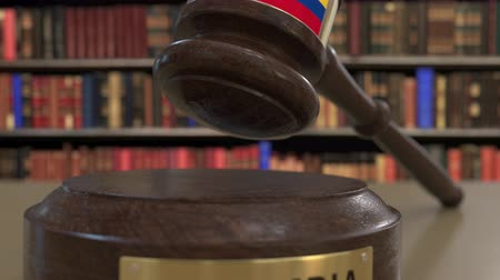 jurisdiction : Flag of Colombia on falling judges gavel in court. National justice or jurisdiction related conceptual 3D animation