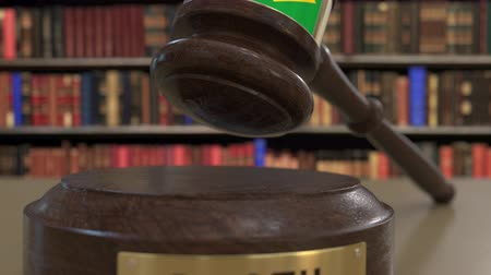 gabela : Flag of Brazil on falling judges gavel in court. National justice or jurisdiction related conceptual 3D animation Stock Footage