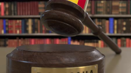jurisdiction : Flag of Romania on falling judges gavel in court. National justice or jurisdiction related conceptual 3D animation