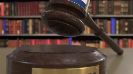 jurisdiction : Flag of the Netherlands on falling judges gavel in court. National justice or jurisdiction related conceptual 3D animation
