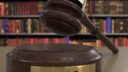 signs of the criminal : Flag of the United Arab Emirates UAE on falling judges gavel in court. National justice or jurisdiction related conceptual 3D animation Stock Footage