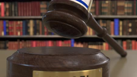 jurisdiction : Flag of Israel on falling judges gavel in court. National justice or jurisdiction related conceptual 3D animation Stock Footage