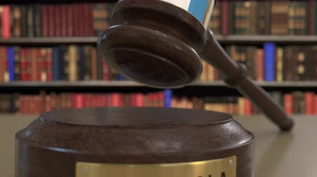 signs of the criminal : Flag of Guatemala on falling judges gavel in court. National justice or jurisdiction related conceptual 3D animation