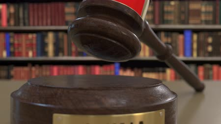 jurisdiction : Flag of China on falling judges gavel in court. National justice or jurisdiction related conceptual 3D animation