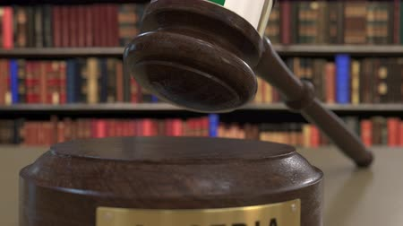 jurisdiction : Flag of Algeria on falling judges gavel in court. National justice or jurisdiction related conceptual 3D animation