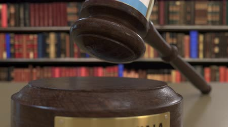 судья : Flag of Argentina on falling judges gavel in court. National justice or jurisdiction related conceptual 3D animation