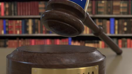 jurisdiction : Flag of Australia on falling judges gavel in court. National justice or jurisdiction related conceptual 3D animation