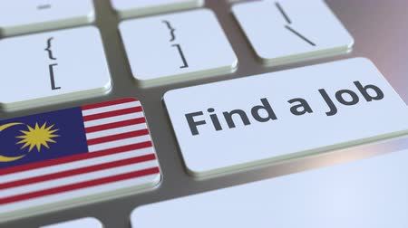 трудовые ресурсы : FIND A JOB text and flag of Malaysia on the buttons on the computer keyboard. Employment related conceptual 3D animation