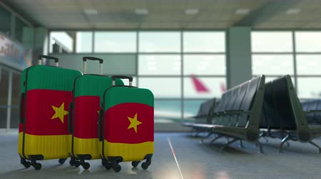 ağır çekimli : Travel suitcases with flag of Cameroon. Cameroonian tourism conceptual 3D animation