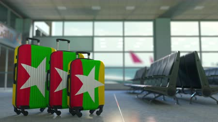 mianmar : Travel suitcases with flag of Myanmar. Myanma tourism conceptual 3D animation Stock Footage