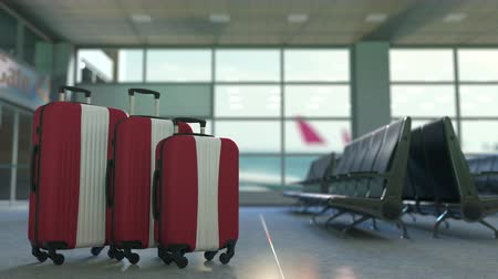 Латвия : Travel suitcases with flag of Latvia. Latvian tourism conceptual 3D animation