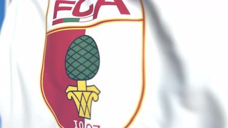 augsburg : Flying flag with FC Augsburg football club logo, close-up. Editorial loopable 3D animation