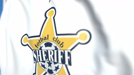 sheriff : Waving flag with FC Sheriff Tiraspol football club logo, close-up. Editorial loopable 3D animation Stock Footage