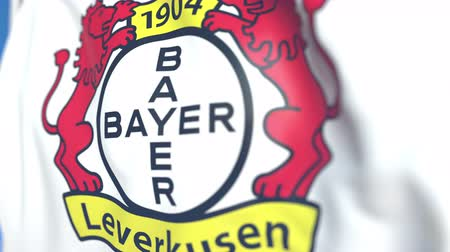 soar : Waving flag with Bayer Leverkusen football club logo, close-up. Editorial loopable 3D animation