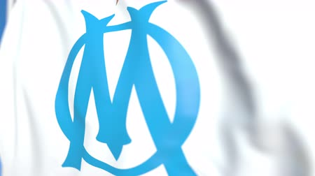 marseille : Waving flag with Olympique de Marseille football club logo, close-up. Editorial loopable 3D animation Stock Footage
