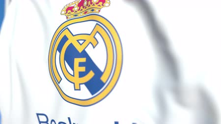 real madrid : Flying flag with Real Madrid football team logo, close-up. Editorial loopable 3D animation Stock Footage