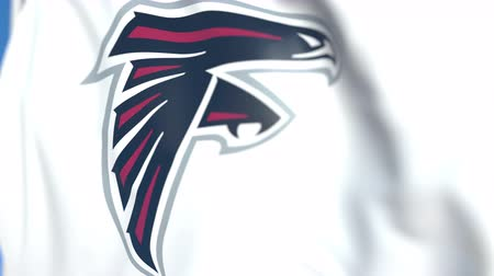 symbolic : Flying flag with Atlanta Falcons team logo, close-up. Editorial loopable 3D animation