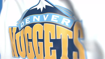 denver : Flying flag with Denver Nuggets team logo, close-up. Editorial loopable 3D animation