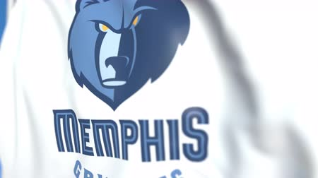 symbolic : Flying flag with Memphis Grizzlies team logo, close-up. Editorial loopable 3D animation