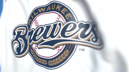 symbolic : Waving flag with Milwaukee Brewers team logo, close-up. Editorial loopable 3D animation