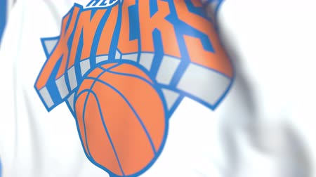 flapping : Waving flag with New York Knicks team logo, close-up. Editorial loopable 3D animation