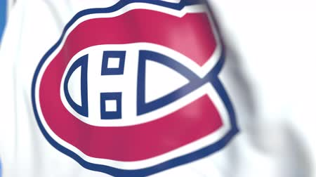 championnat : Waving flag with Montreal Canadiens NHL hockey team logo, close-up. Editorial loopable 3D animation Vidéos Libres De Droits