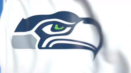 flapping : Waving flag with Seattle Seahawks team logo, close-up. Editorial loopable 3D animation