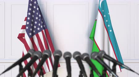 oezbekistan : Flags of the USA and Uzbekistan at international meeting or conference. 3D animation