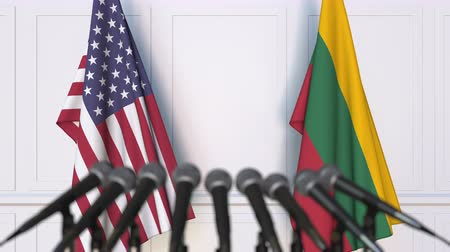 flag of lithuania : Flags of the United States and Lithuania at international meeting or conference. 3D animation Stock Footage