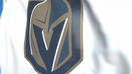 lovagi torna : Waving flag with Vegas Golden Knights NHL hockey team logo, close-up. Editorial loopable 3D animation