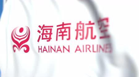 symbolic : Flying flag with Hainan Airlines logo, close-up. Editorial loopable 3D animation Stock Footage