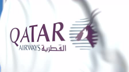 oficiální : Waving flag with Qatar Airways logo, close-up. Editorial loopable 3D animation