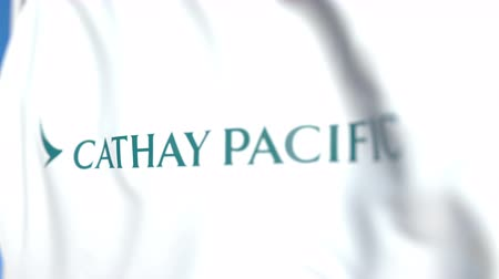 symbolic : Waving flag with Cathay Pacific logo, close-up. Editorial loopable 3D animation